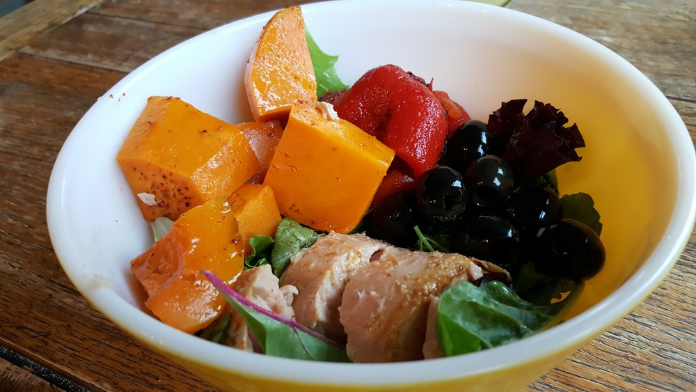 Breakfast bowl of butternut squash, tuna, olives and red peppers