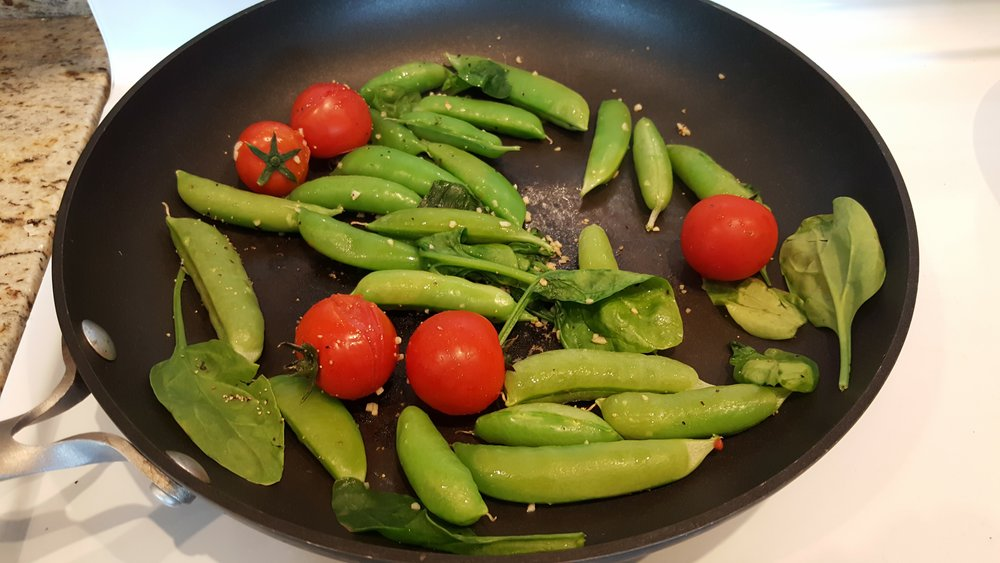 The freshest snap peas and tomatoes for breakfast