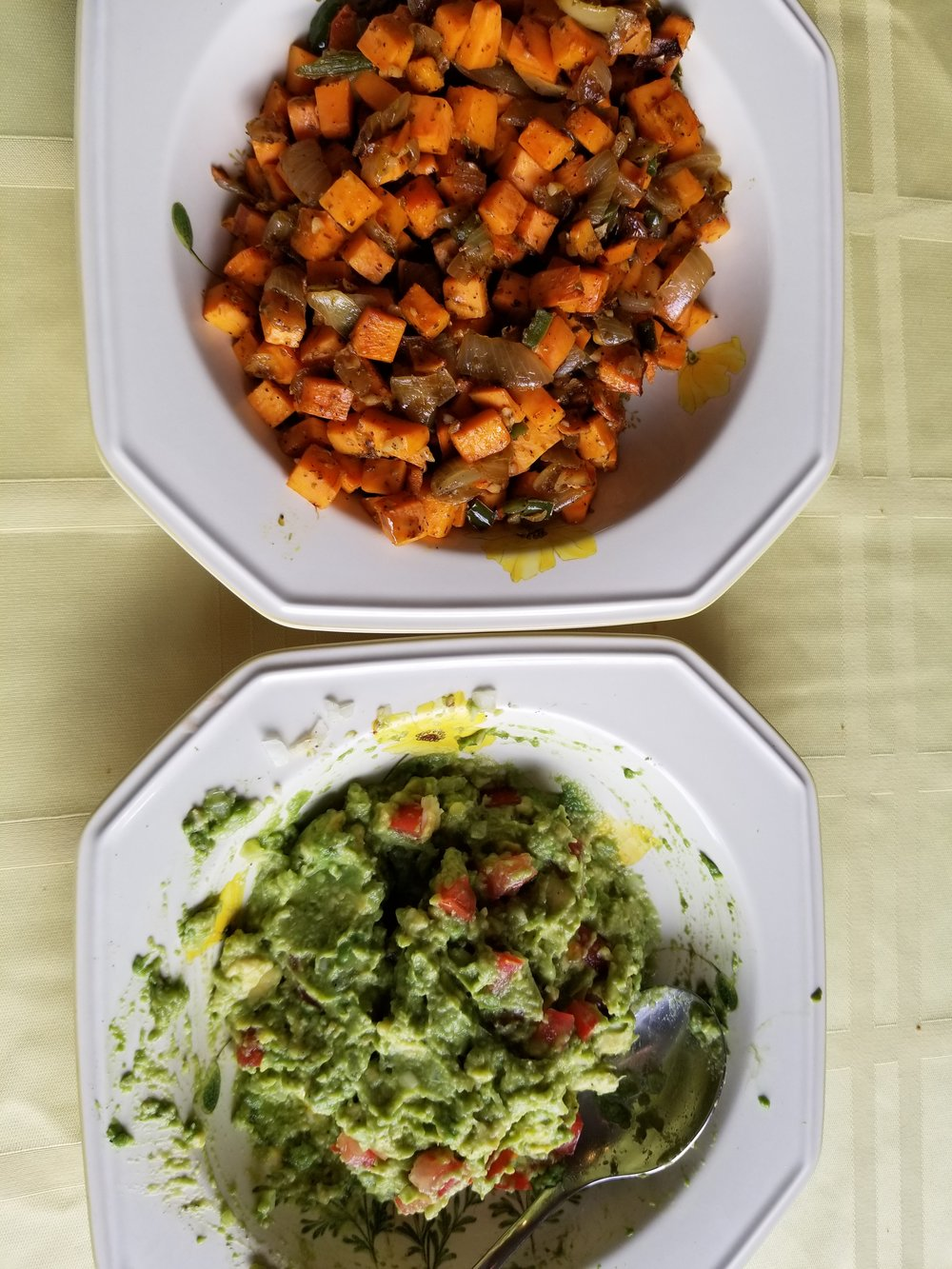 "This is a plate of sweet potatoes and a side of guacamole. This was my husband and my Thanksgiving ""feast"". We are really grateful for all the friends we have made along this journey. It is not traditional, but the flavors of the sweet potatoes were very satisfying."