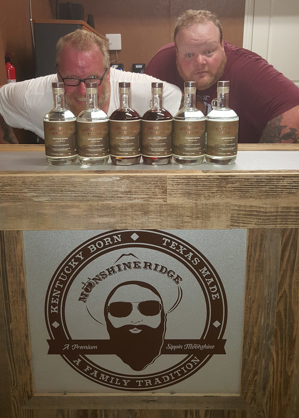 Mr. Shine and Kat Daddy with a few of the finished bottles.