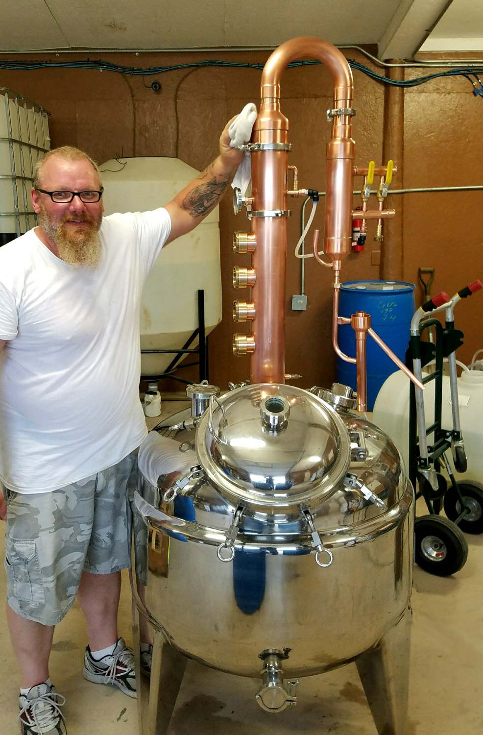 Tom cleaning the still. Isn't she pretty?!