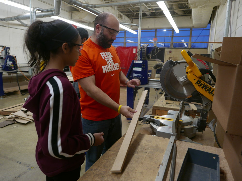 Hersey instructor Rich Hyde works with middle school students in the NGE after-school program.