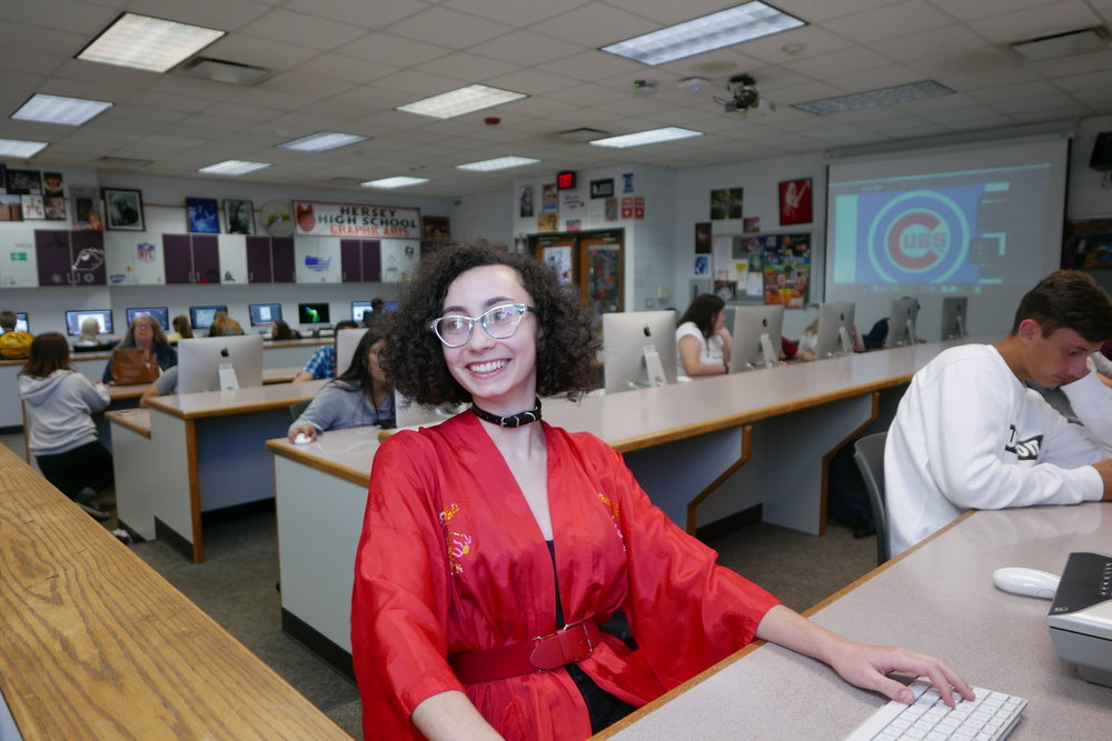 Zoe Axelrod sits in her Advanced Placement Studio Art 2-D class at John Hersey High School. The senior's design was recently featured on the cover of a national trade publication.