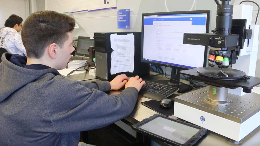 Wheeling High school senior Brandon Zettek works on a project in his college introduction to nanotechnology class.