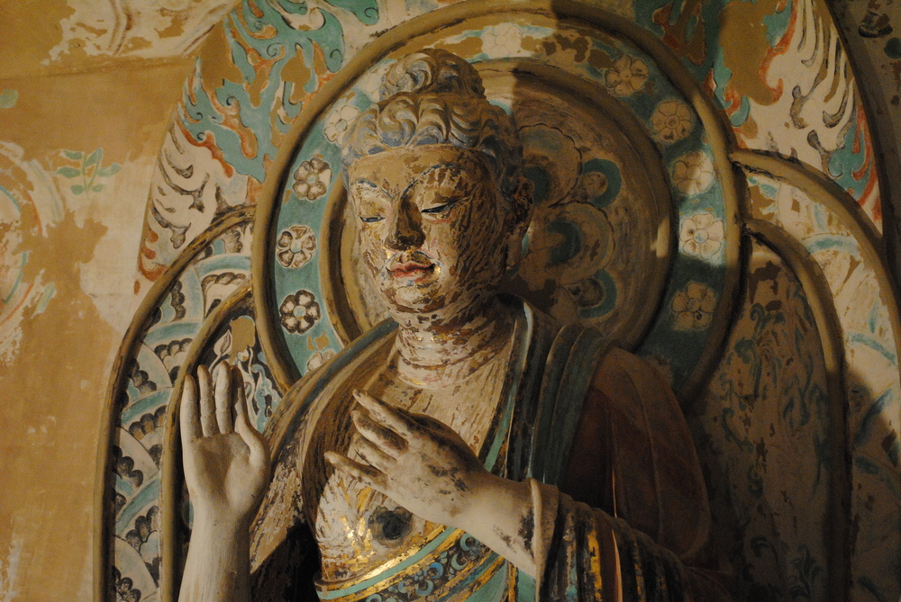 A statue of a Buddha inside the replica Cave 320 (8th century CE).