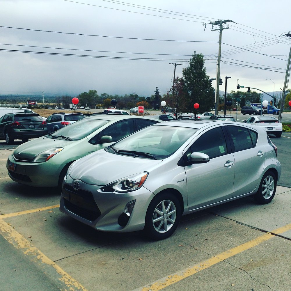 Our old Prius, on the left, and our new-to-us Prius C on the right. November 2015.