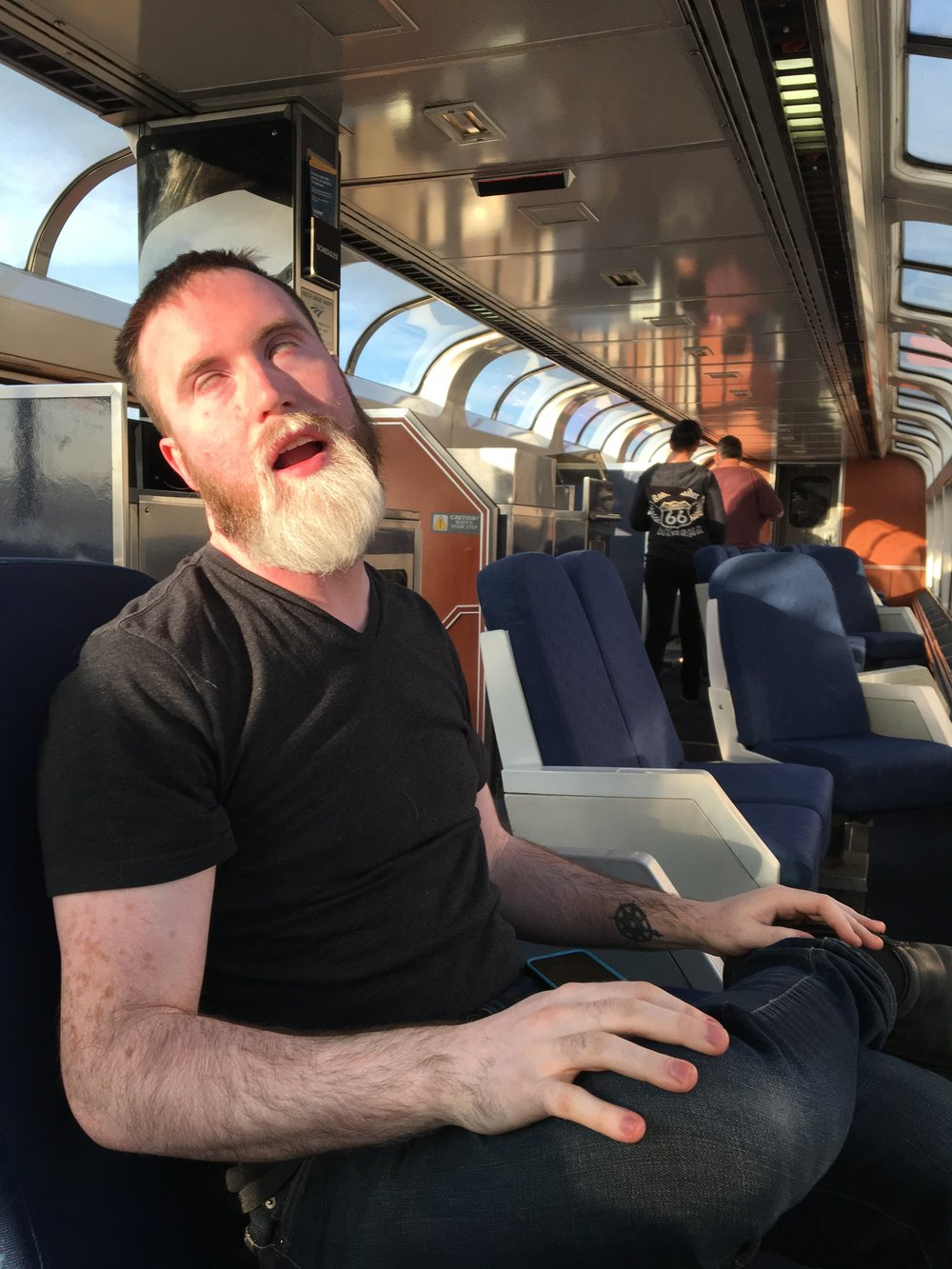 Dan makes faces for my camera in the Observation car. It took three tries to get a decent shot of him, silly guy.
