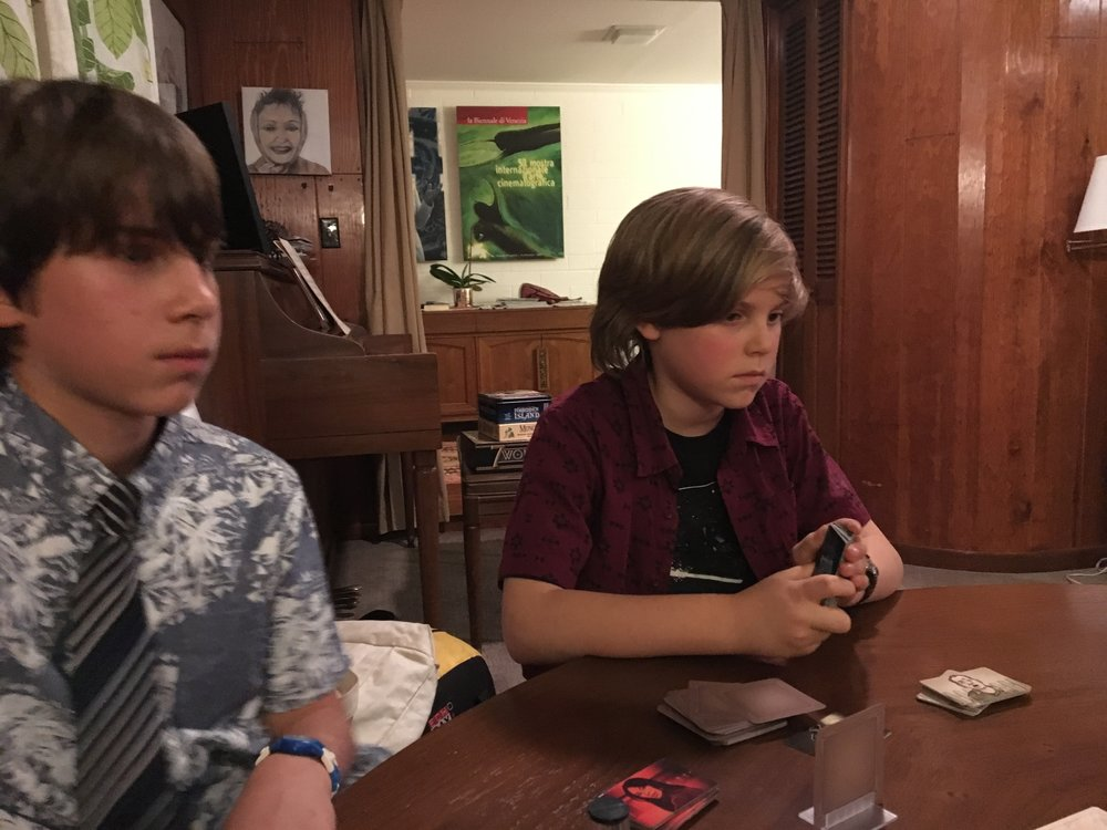 M and L thinking pretty hard as they are acting as the Codemasters in Codenames!