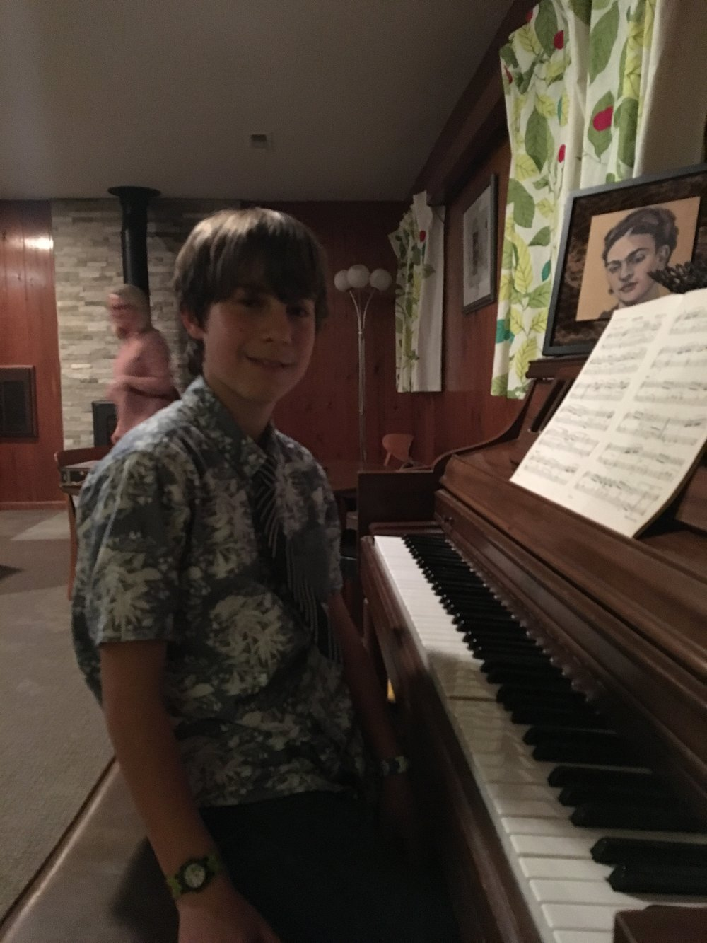 L at the piano.