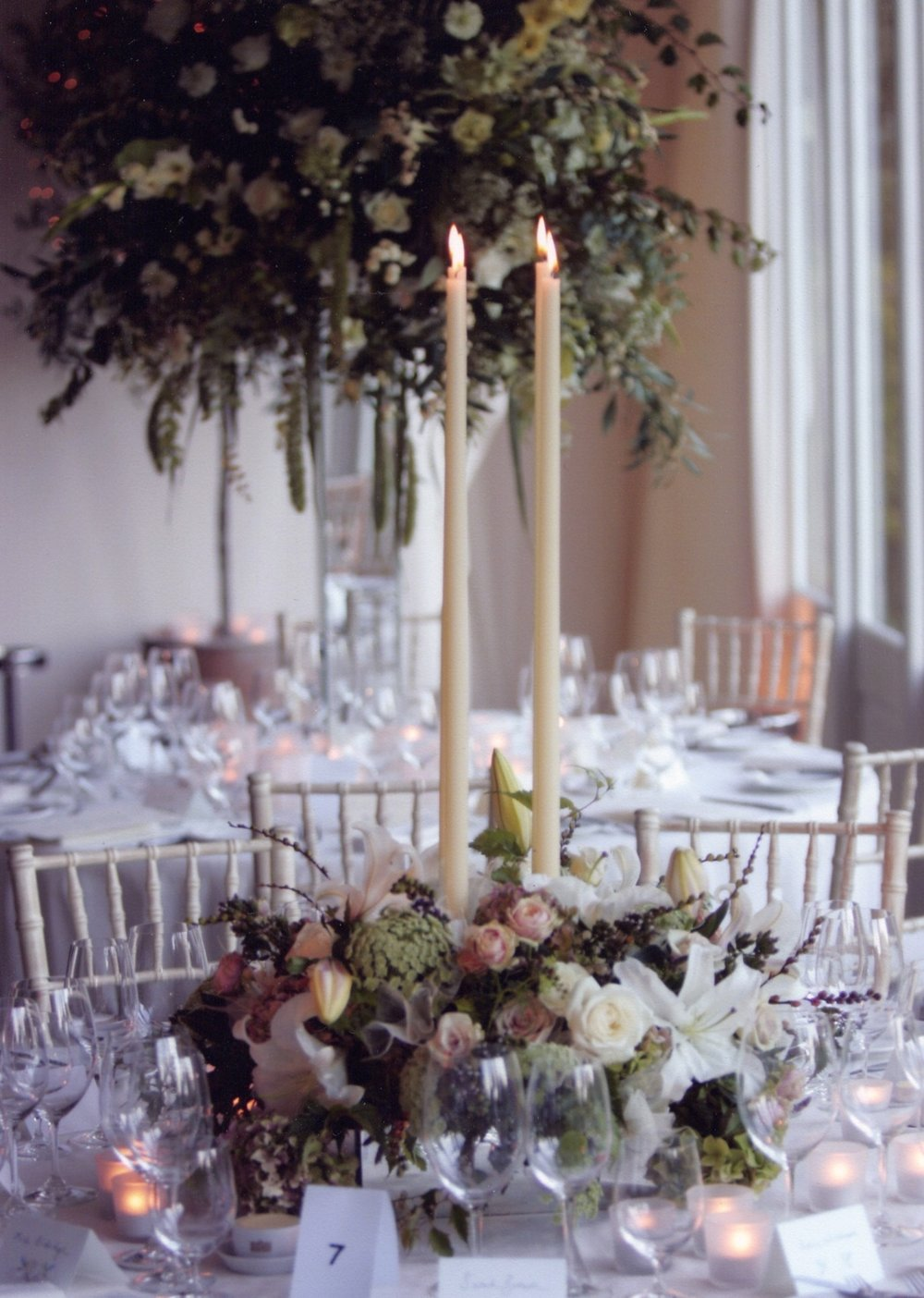 High and low mirror arrangements in soft colours with candles.jpg
