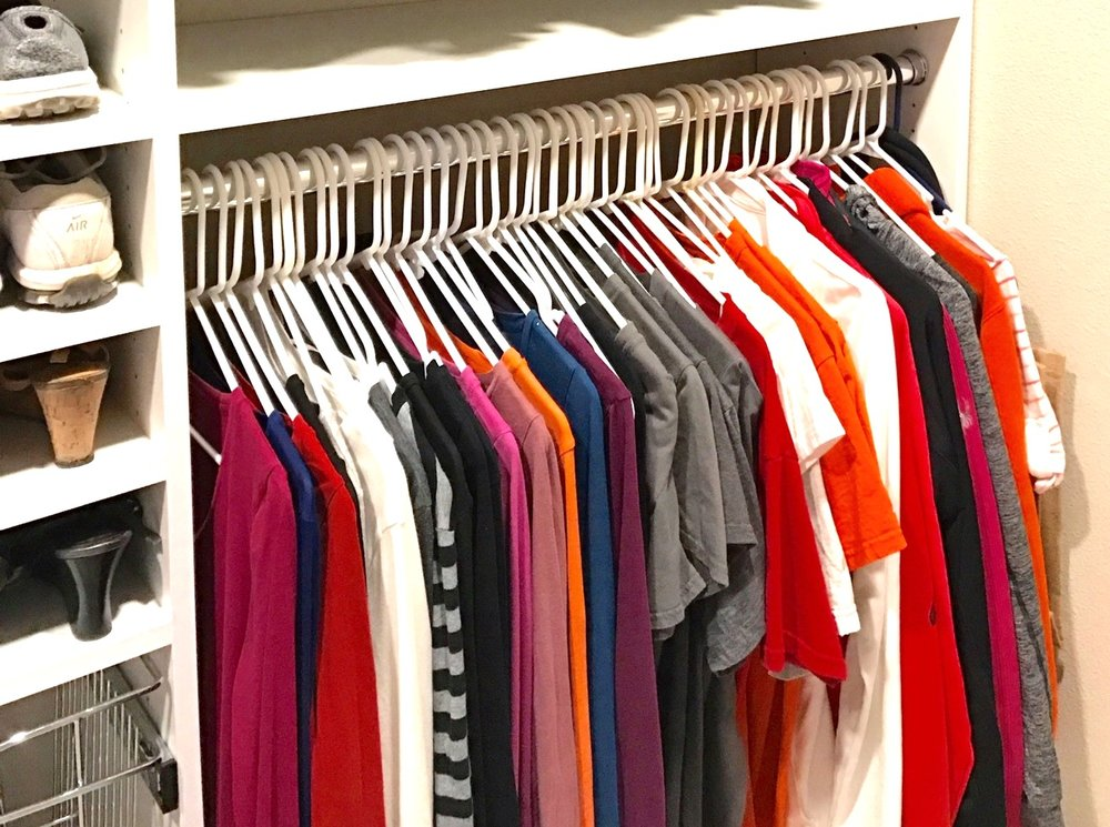 Plastic hangers are a quick and easy way to store T-shirts and other casual tops.  Call Closets of Tulsa  today for a FREE consultation and 3-D closet design:  918.609.0214