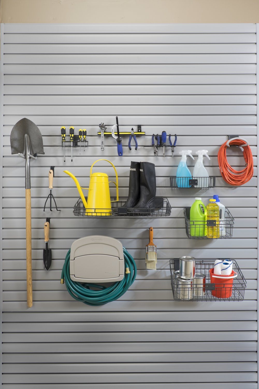 The slatwall provides clean, accessible storage for garden sheds and garage organization.  Call Closets of Tulsa  today for a FREE consultation and 3-D garage design:  918.609.0214