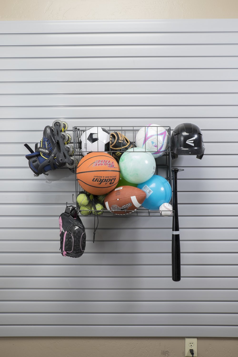 A slatwall keeps sporting goods organized and off the floor.  Call Closets of Tulsa  today for a FREE consultation and 3-D garage design:  918.609.0214