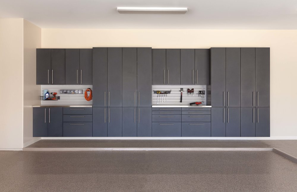 Custom garage shelving makes garage organization easy and attainable.  Call Closets of Tulsa  now for your FREE consultation and 3-D garage design:  918.609.0214 . Pictured: Dark grey garage cabinets with custom drawer pulls, tool chest and slatwall storage.