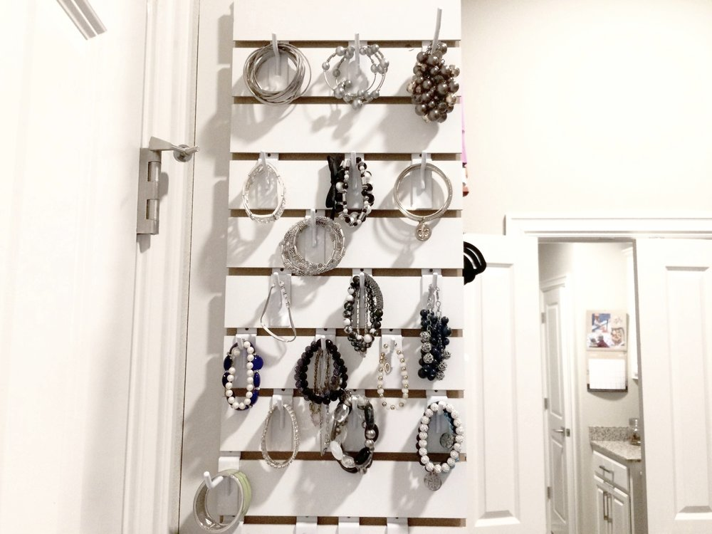 The jewelry slatwall in my own wardrobe closet fits snugly on the side of my shoe rack, next to the door to my master bathroom.