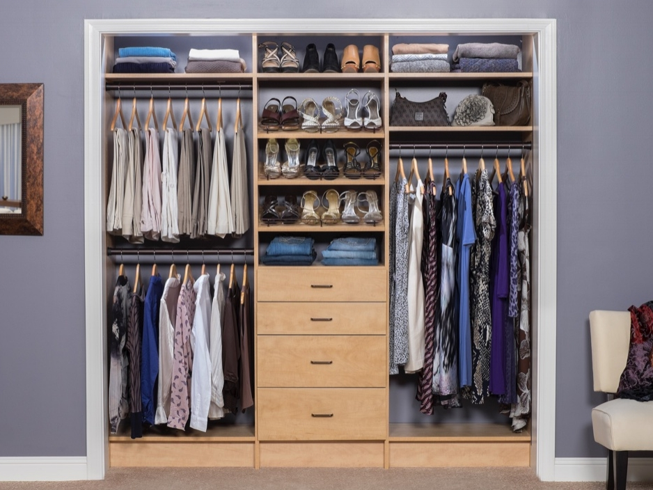 Custom closet shelving, clear divisions of space, a stylish and functional shoe rack, and easy-access drawers give this small closet a major makeover.