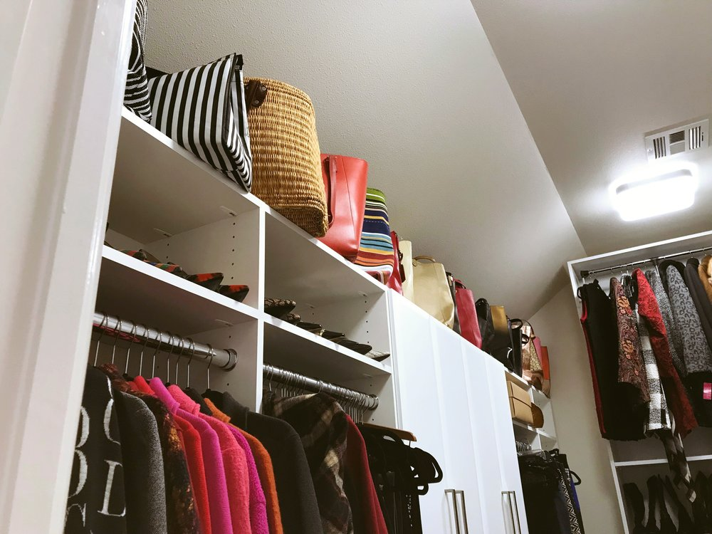 This custom closet organizer by Closets of Tulsa maximizes vertical storage so no space goes to waste.