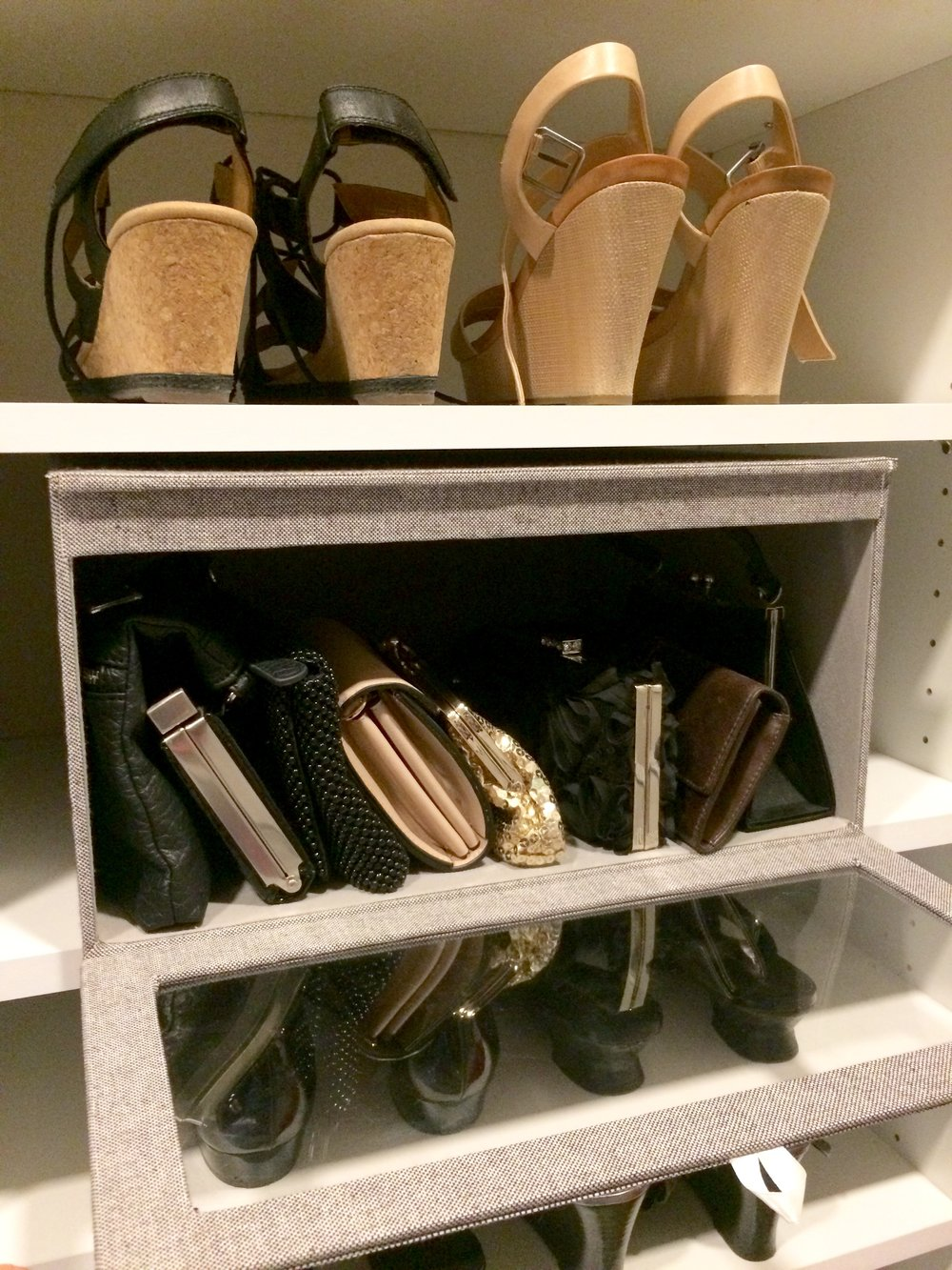 A closet storage box with a transparent panel keeps valuables organized and accessible.  Call Closets of Tulsa  now for your FREE consultation and 3-D closet design:  918.609.0214