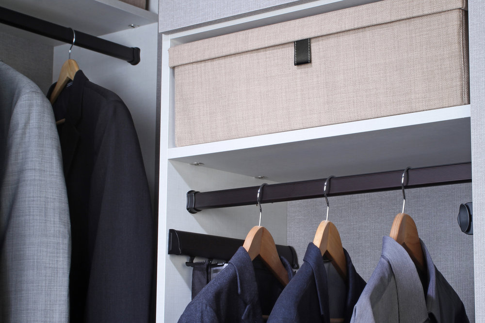 To create space in your closet, store off-season clothes in durable storage boxes on your top shelves.  Call Closets of Tulsa  now for your FREE consultation and 3-D closet design:  918.609.0214