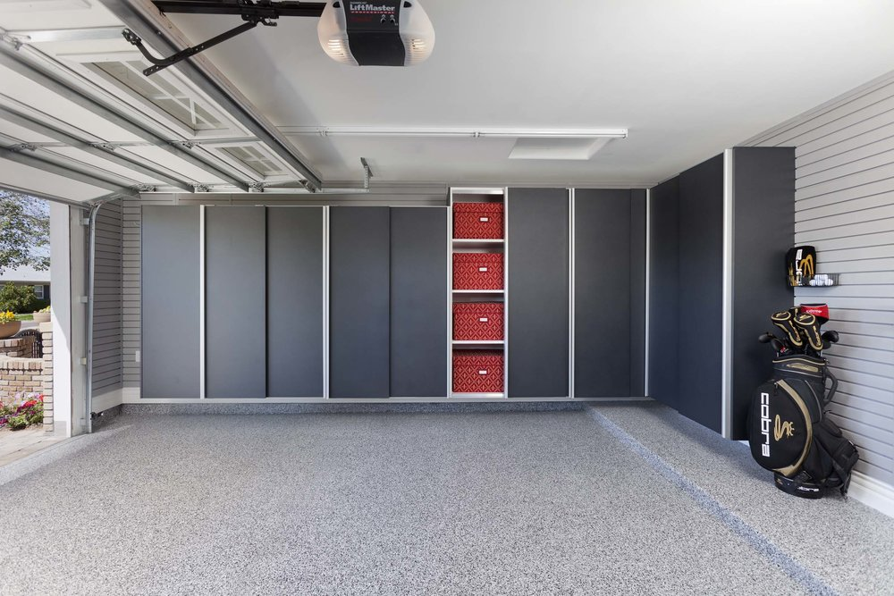 Wall mounted garage cabinets by Closets of Tulsa keep your storage system and your floors clean and clutter-free.