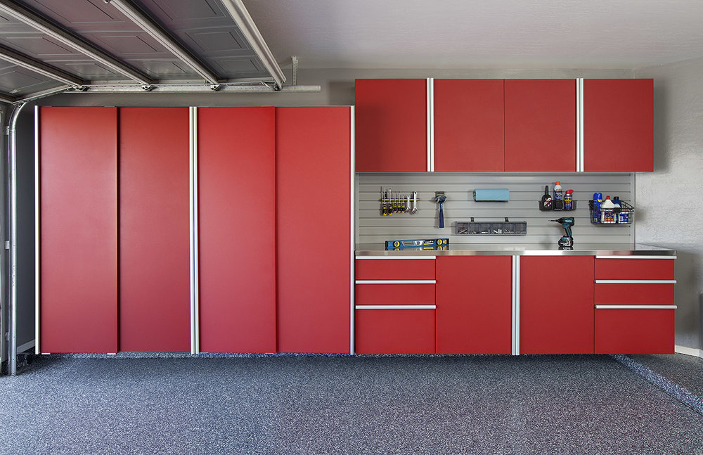 A stainless steel workbench makes these powder coated red garage cabinets pop. As a bonus, the slatwall backsplash maximizes tool storage.  Call Closets of Tulsa  now for your FREE consultation and 3-D garage design:  918.609.0214