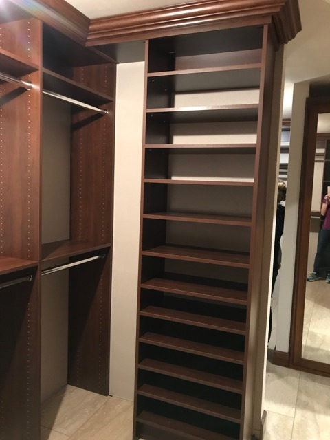 Crown molding draws the eye all the way to the top of this custom shoe rack by Closets of Tulsa.  Call now  for a FREE consultation and 3-D closet design:  918.609.0214