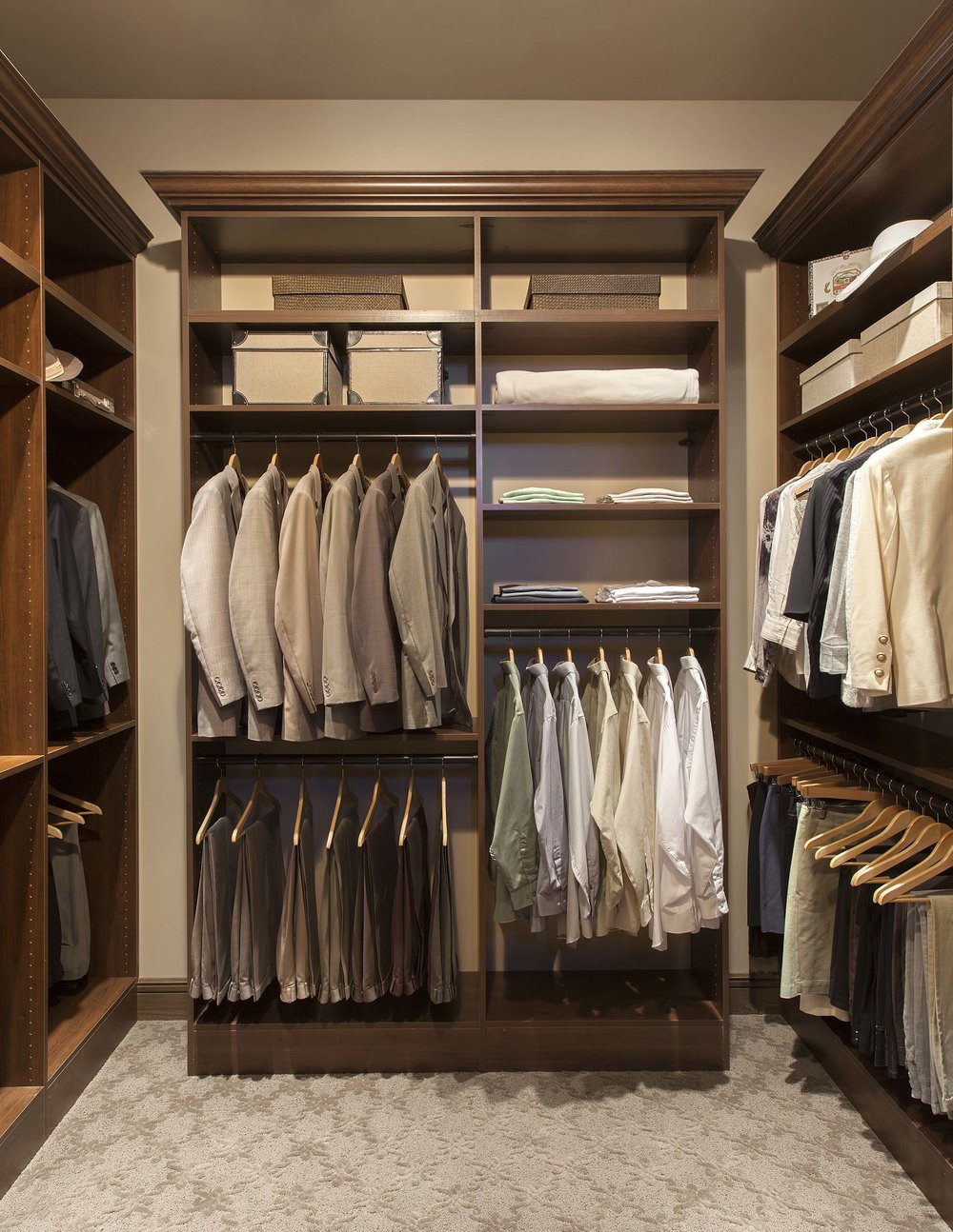 Crown molding is a standout detail in this handsome custom closet.  Call Closets of Tulsa  for a FREE consultation and 3-D closet design:  918.609.0214