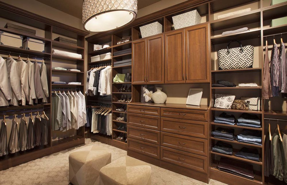 Closet drawers by Closets of Tulsa come in custom styles and finishes for every taste and budget. This drawer and cabinet configuration looks and functions like a built-in armoire.