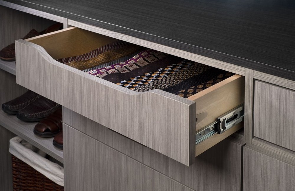 The scoop front tie drawer by Closets of Tulsa adds a sophisticated, boutique feel to any custom closet design.