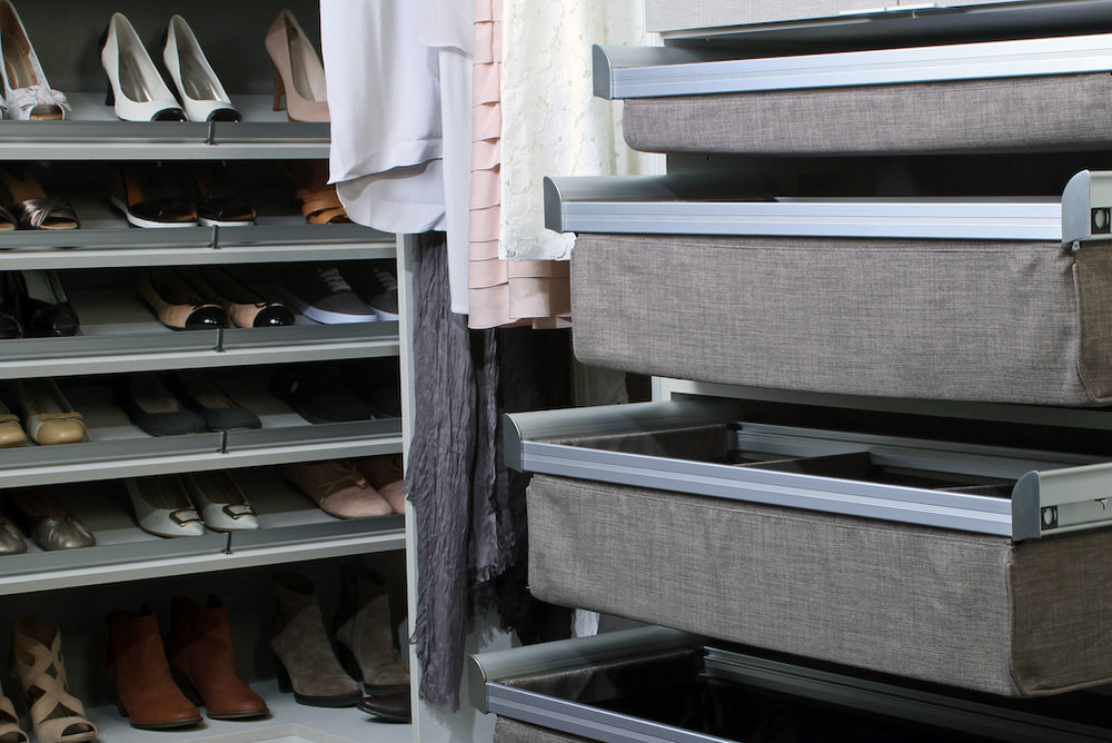 These soft-sided closet drawers from TAG Hardware come in several colors and finishes, with drawer dividers to stay organized.  Call Closets of Tulsa  for your FREE consultation and 3-D closet design:  918.609.0214