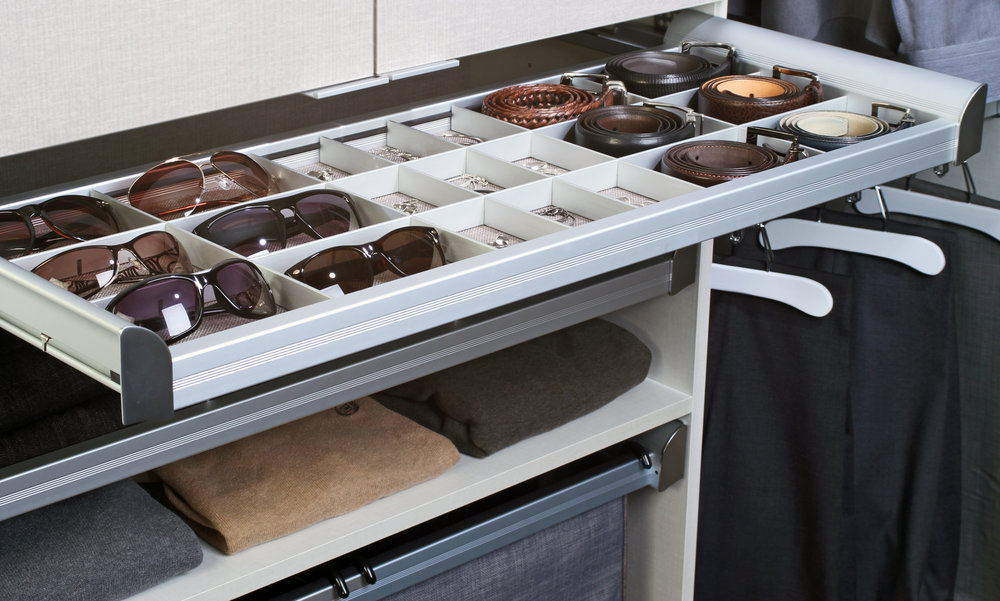 This low-profile closet drawer by TAG Hardware provides a convenient home for your wallet, keys and change.  Call Closets of Tulsa  for your FREE consultation and 3-D closet design:  918.609.0214