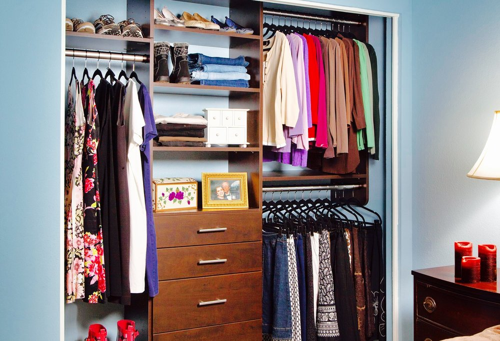 Closet drawers keep spaces of any size more organized. The drawers in this small bedroom closet help streamline the visual field by keeping some items off display.
