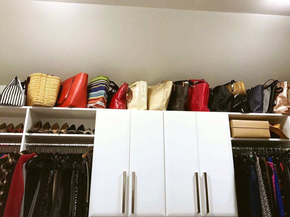 Open shelving for purses and totes maximizes the storage potential of this tall closet by Closets of Tulsa.  Call now  for a FREE consultation and 3-D closet design:  918.609.0214