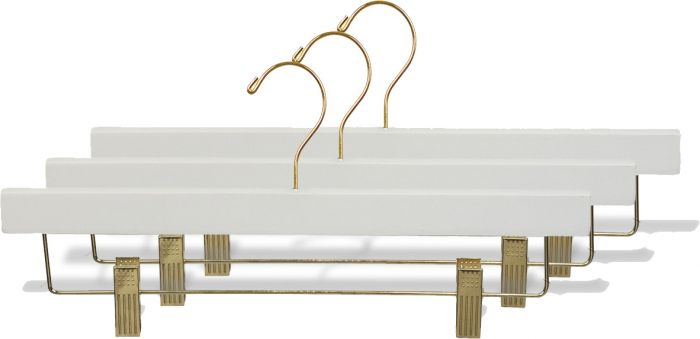 Use promo code TULSA for 15% off these white wood and brass hangers at  Hangers.com .