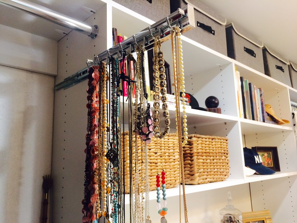 This sliding belt rack by Closets of Tulsa doubles as a clutter-busting jewelry organizer.