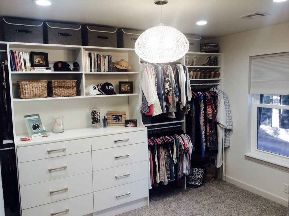Luxe lighting and a built-in double hutch make this bedroom closet conversion feel like a natural extension of the master.
