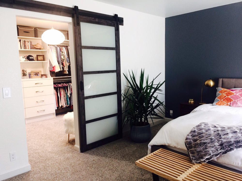 This spacious converted master closet by Closets of Tulsa was once a small spare bedroom with a separate entry.