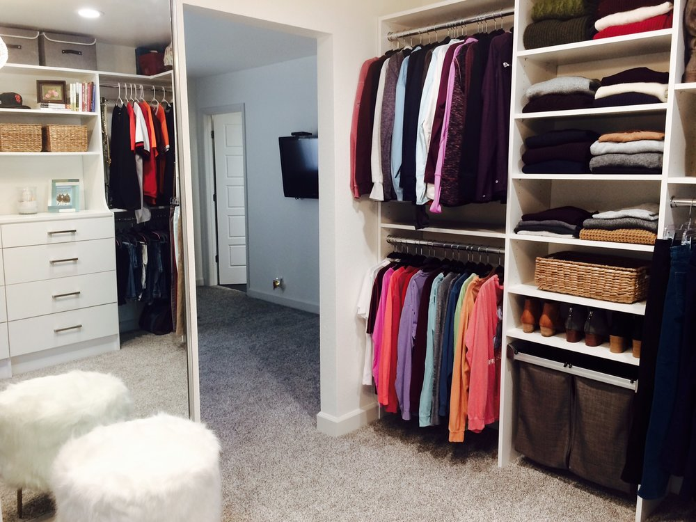 A full length mirror and furry vanity stool turn up the glamour in this bedroom closet conversion by Closets of Tulsa.