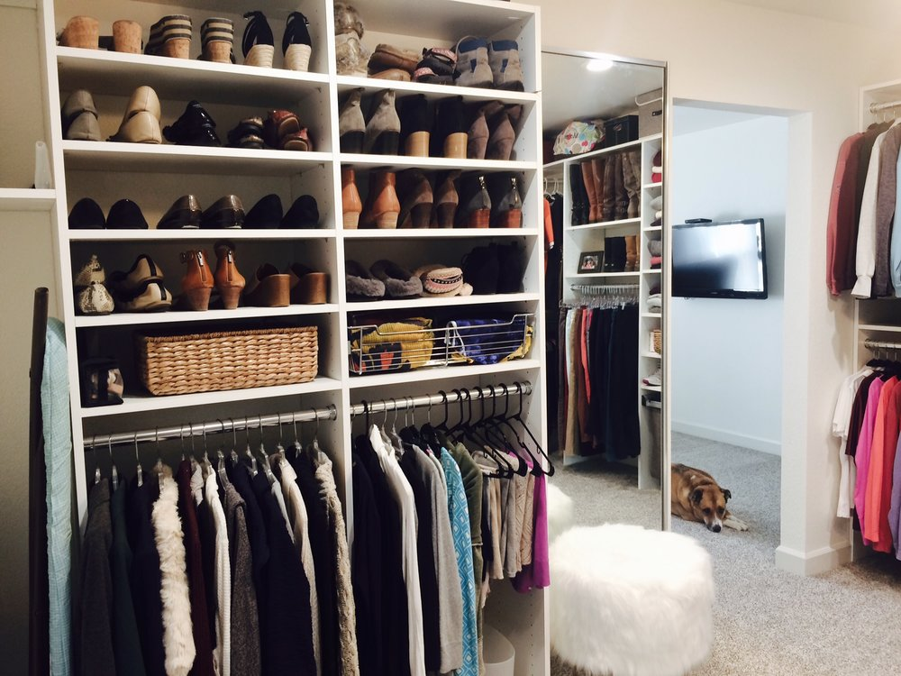 The client selected flat shoe rack shelving to display purses, storage baskets and shoes together in her bedroom closet conversion.