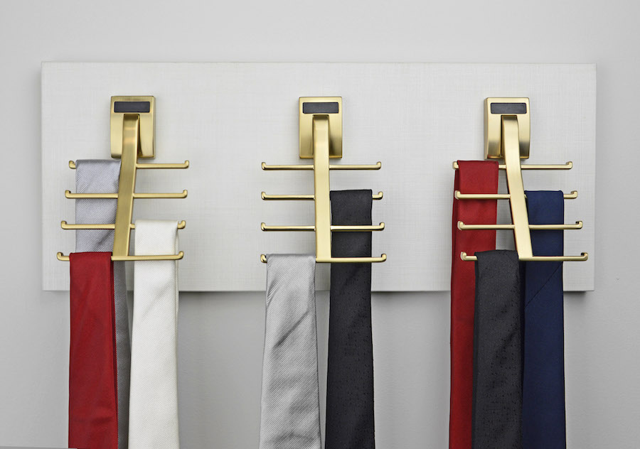 Matte gold multi-hook tie racks by Closets of Tulsa are an elegant and space saving solution.