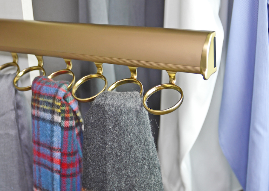 This matte gold scarf organizer by Closets of Tulsa saves space while storing scarves well.
