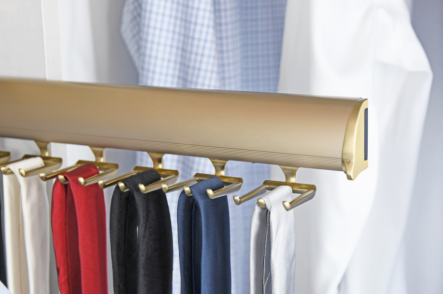 This pullout matte gold tie rack from Closets of Tulsa helps you see what you have and wear more of it.