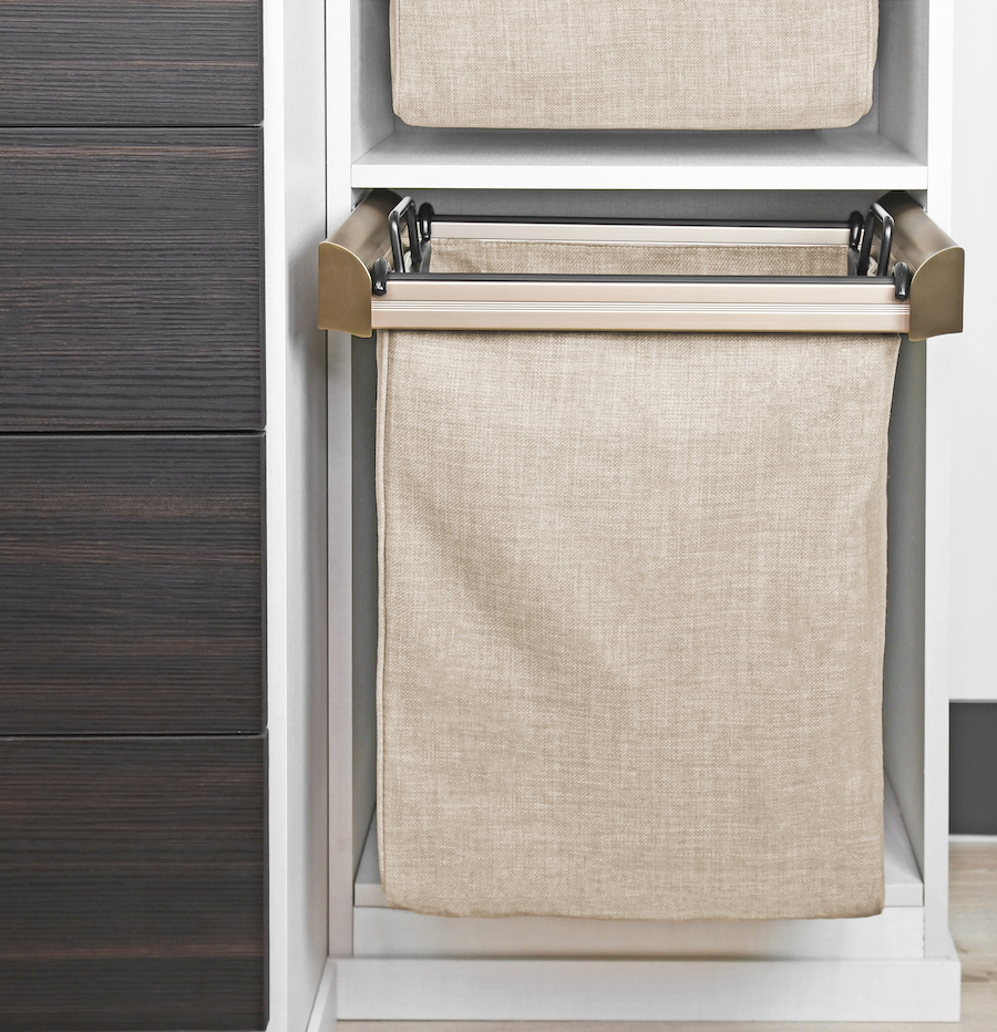 Pullout laundry hampers by Closets of Tulsa come in several finishes as well as single, double and triple hamper designs.