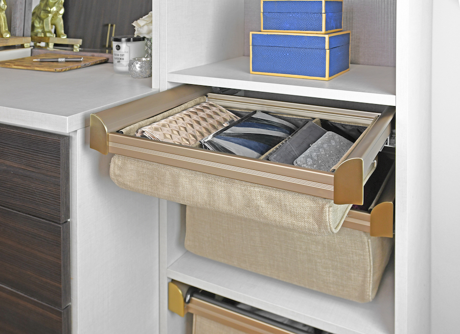 Keep clutches and small accessories organized in shallow soft close drawers from Closets of Tulsa.