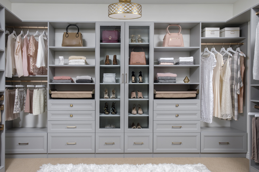Upholstered soft-close drawers in matte gold and beach from Closets of Tulsa offer a streamlined, modern alternative to typical closet storage. To combine with conventional drawers, choose from a variety of drawer sizes and styles and select drawer pulls that suit your taste.