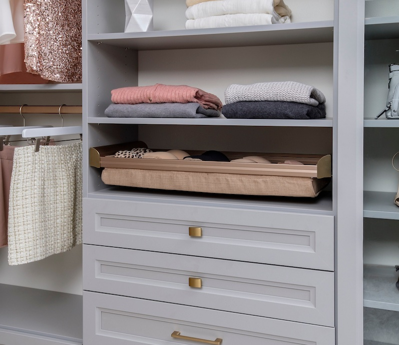 For a classic modern closet, combine conventional custom drawers with soft close upholstered drawers.  Call Closets of Tulsa  today for a FREE consultation and 3-D closet design:  918.609.0214