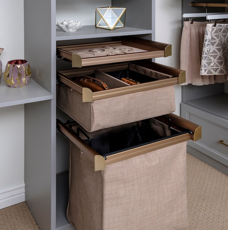 For a stylish, efficient closet layout, stack soft close drawers with a pullout laundry hamper.  Call Closets of Tulsa  now for your FREE consultation and 3-D closet design:  918.609.0214