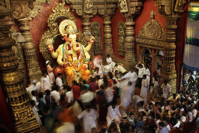 Devotees doing Pradakshina aroung Lord Ganesha