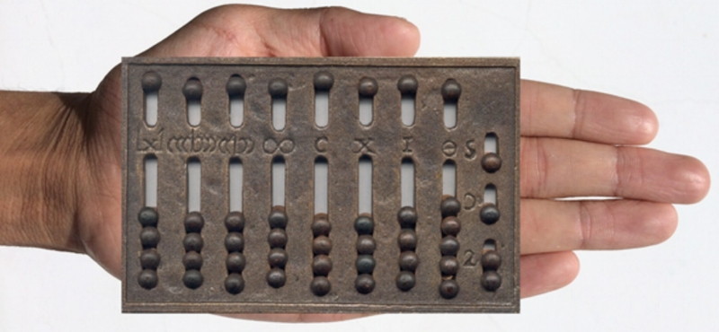 Roman hand Abacus By Razumhak (Own work) [CC BY-SA 3.0 via Wikimedia Commons]