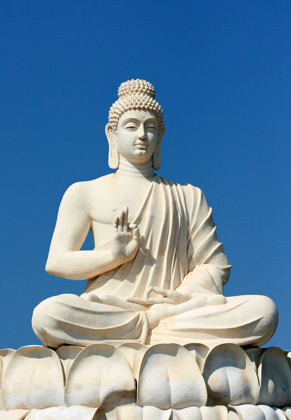 "Purshi, ""Buddha's Statue Located Near Belum Caves, India"", via Wikimedia Commons, Public Domain."